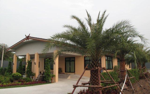 Отель QG Resort вид на фасад