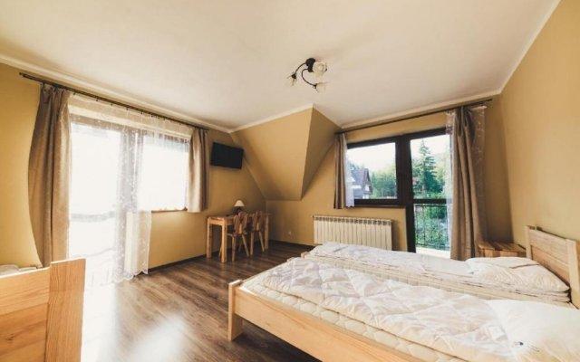 Отель Pokoje i Apartamenty Nad Potokiem Закопане комната для гостей