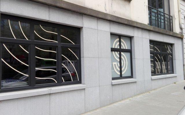 Отель Smartflats Design - Schuman Брюссель вид на фасад