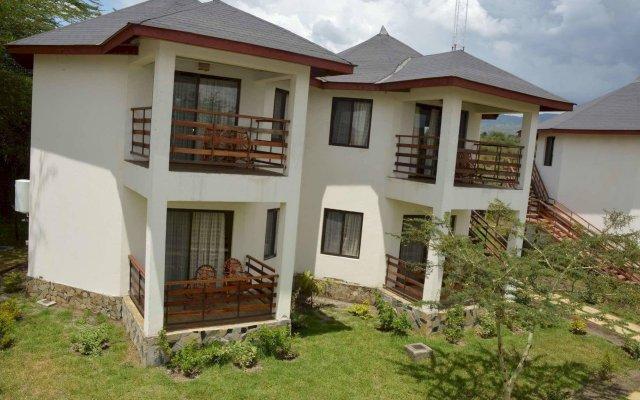 Отель Sentrim Elementaita Lodge Кения, Накуру - отзывы, цены и фото номеров - забронировать отель Sentrim Elementaita Lodge онлайн вид на фасад