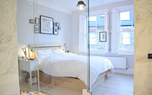 Отель Modern and Spacious Belsize Park Apartment Великобритания, Лондон - отзывы, цены и фото номеров - забронировать отель Modern and Spacious Belsize Park Apartment онлайн комната для гостей