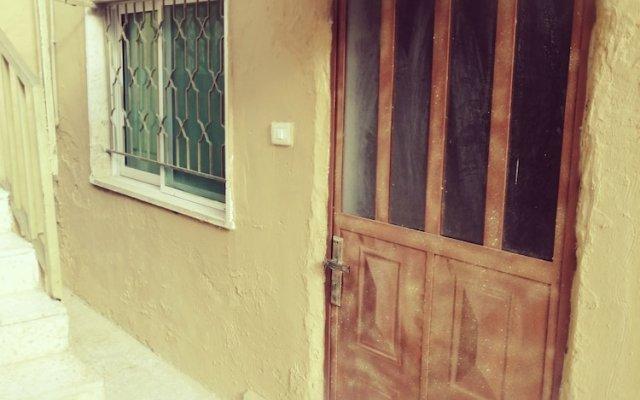 Отель Ibn Khaldoon Apartment Иордания, Мадаба - отзывы, цены и фото номеров - забронировать отель Ibn Khaldoon Apartment онлайн вид на фасад