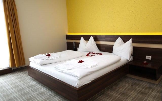 Primus Hotel & Apartments комната для гостей