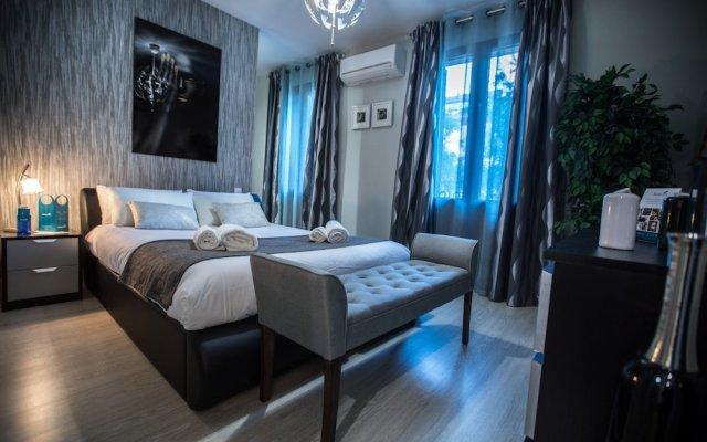 Апартаменты Sweet Inn Apartments Lavapiés Мадрид комната для гостей