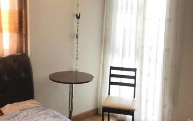 Отель The Fah Condominium Бангкок комната для гостей