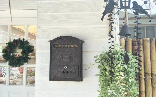 Отель Little Latte House вид на фасад