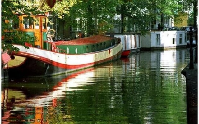 Houseboat in Amsterdam Old Center