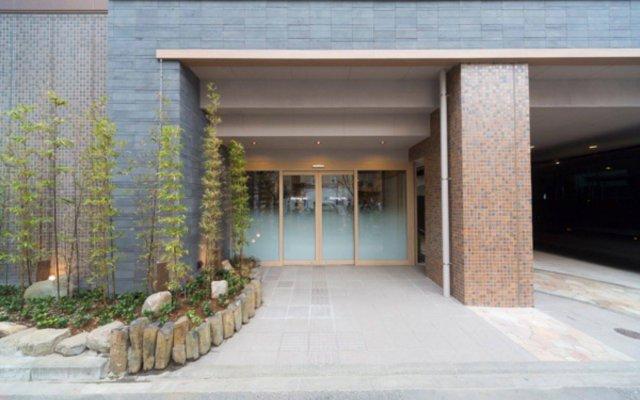 Отель Dormy Inn Tokyo-Hatchobori Natural Hot Spring вид на фасад