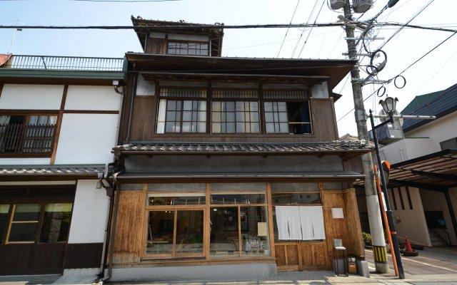Taketa station hostel cue Минамиогуни вид на фасад
