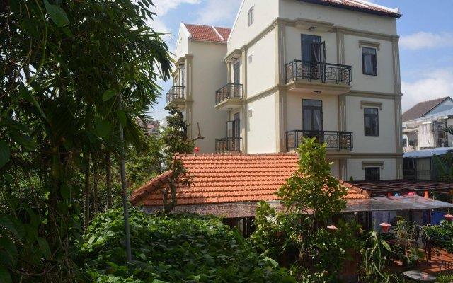 Отель Botanic Garden Villas вид на фасад