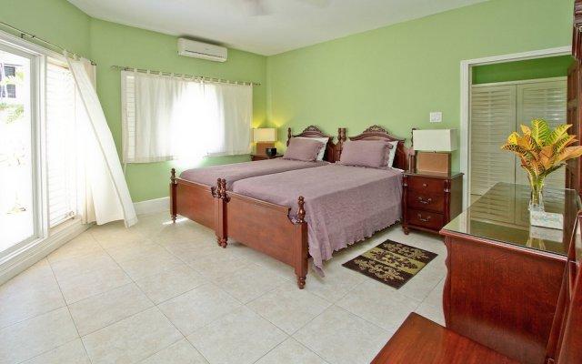 Отель Azure Cove, Silver Sands. Jamaica Villas 5BR комната для гостей