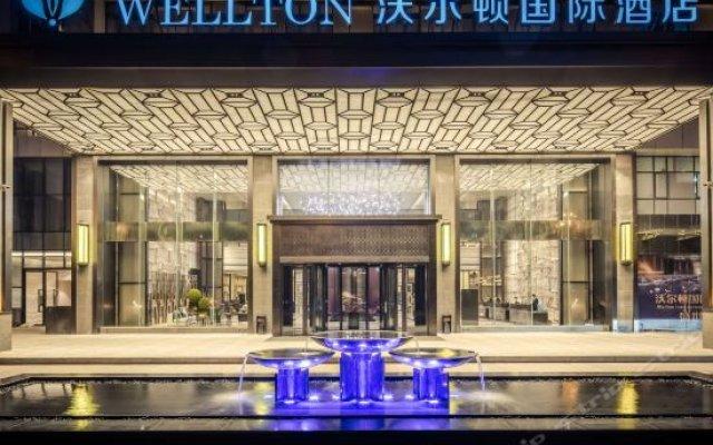 Wellton International Hotel (Ganzhou Xinghai Tiancheng) вид на фасад