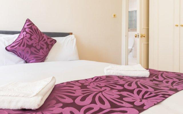 Отель Belgravia Apartments - Grosvenor Gardens Великобритания, Лондон - отзывы, цены и фото номеров - забронировать отель Belgravia Apartments - Grosvenor Gardens онлайн комната для гостей