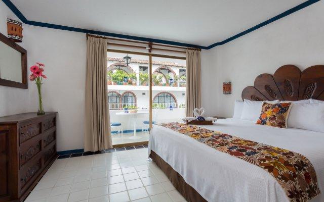 Отель Los Arcos Suites Пуэрто-Вальярта комната для гостей