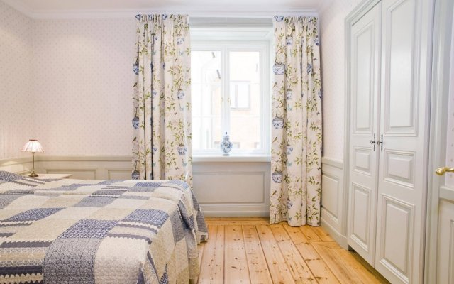 Апартаменты Residence Perseus Apartments комната для гостей