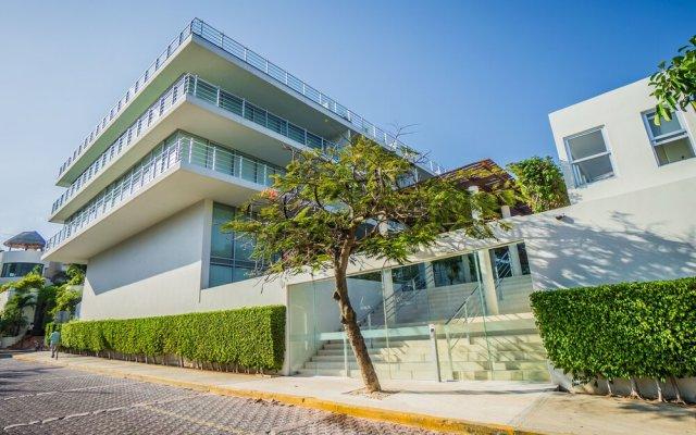 Отель Luxury Condos at Magia Мексика, Плая-дель-Кармен - отзывы, цены и фото номеров - забронировать отель Luxury Condos at Magia онлайн вид на фасад