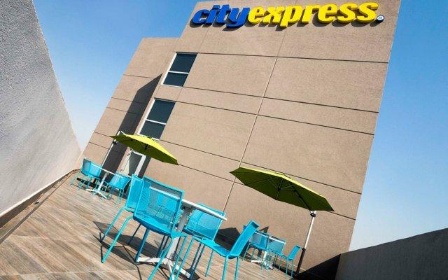 Отель City Express Plus Patio Universidad вид на фасад