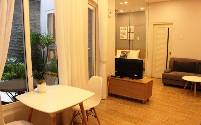 Отель YessHome комната для гостей