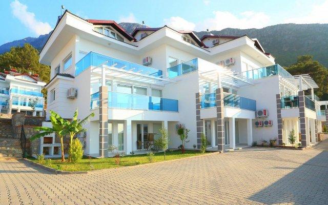 Апартаменты Orka Royal Hills Apartment Олудениз вид на фасад