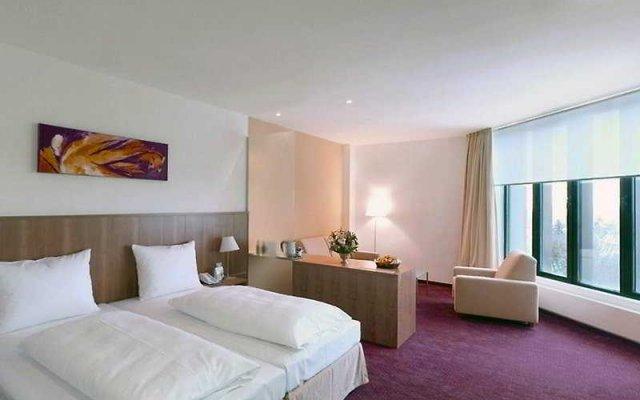 Modul Hotel Вена комната для гостей