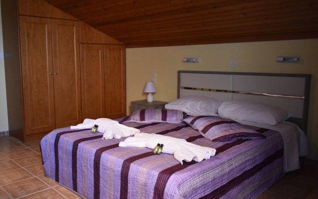 Апартаменты Nikos Apartments комната для гостей