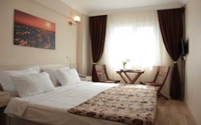 Отель Trio Suites Taksim комната для гостей