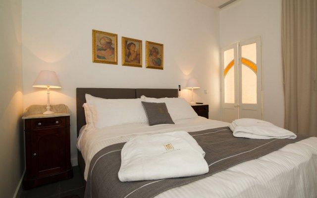 Отель U Collection Townhouse Слима комната для гостей