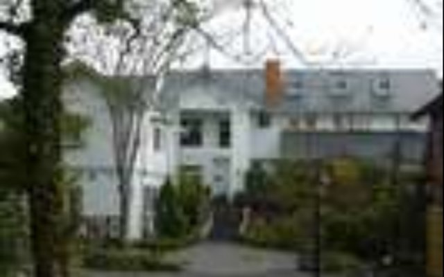 Отель Pension Bell Bird Минамиогуни вид на фасад
