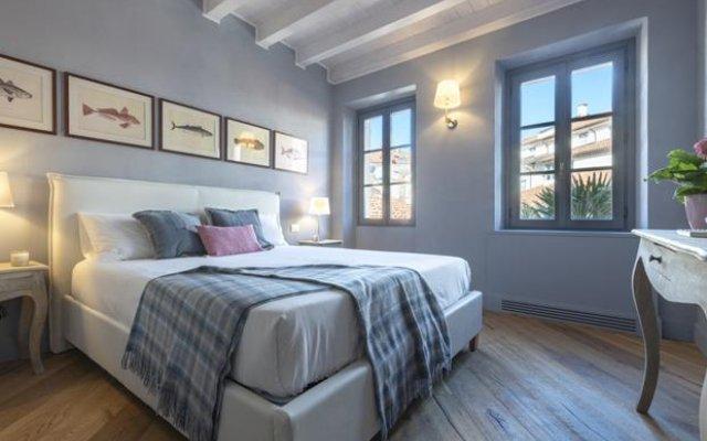 Отель Isola Bella Apartments - Via del Voltone Италия, Стреза - отзывы, цены и фото номеров - забронировать отель Isola Bella Apartments - Via del Voltone онлайн комната для гостей