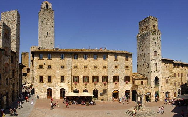 Отель Leon Bianco Италия, Сан-Джиминьяно - отзывы, цены и фото номеров - забронировать отель Leon Bianco онлайн вид на фасад