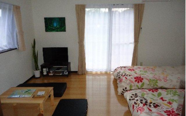 Отель Cottage Kutsuroki Япония, Якусима - отзывы, цены и фото номеров - забронировать отель Cottage Kutsuroki онлайн комната для гостей