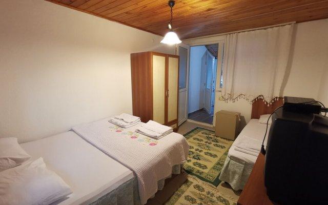 Отель Gulcan Pansiyon комната для гостей