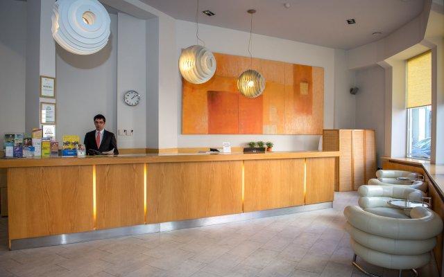 Rixwell Centra Hotel интерьер отеля