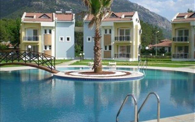 Апартаменты Hisar Garden Apartments Олудениз вид на фасад