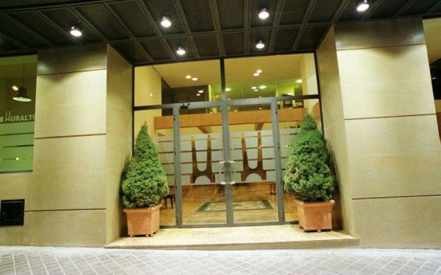 Отель Aparto Suites Muralto вид на фасад