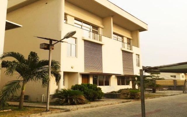 Апартаменты Gemini Place Apartments Oniru вид на фасад