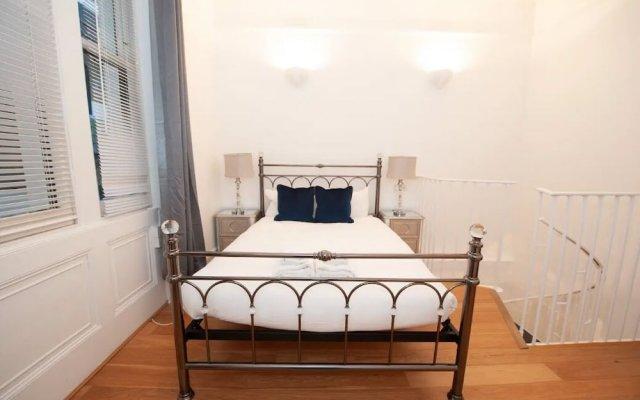 Отель Unique Period Apartment in Kensington Великобритания, Лондон - отзывы, цены и фото номеров - забронировать отель Unique Period Apartment in Kensington онлайн комната для гостей