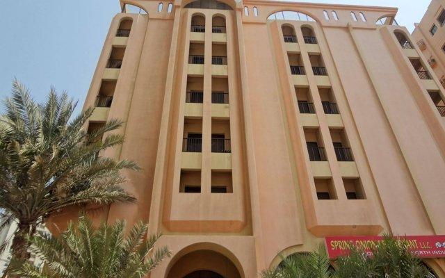 Отель Al Buhaira Hotel Apartments ОАЭ, Шарджа - отзывы, цены и фото номеров - забронировать отель Al Buhaira Hotel Apartments онлайн вид на фасад