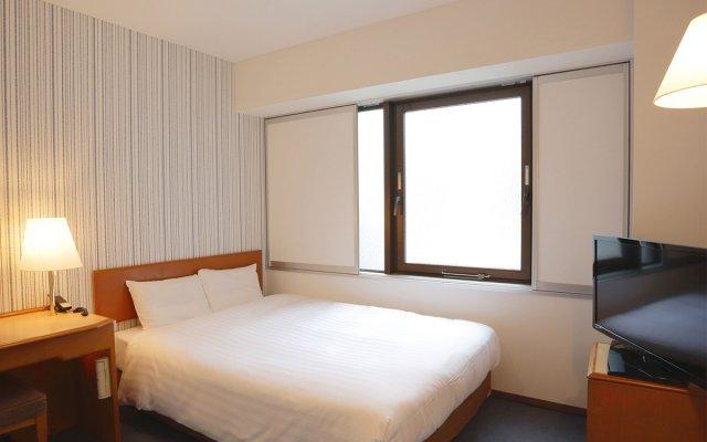 Отель Smille Nihonbashi-Mitsukoshimae Токио комната для гостей