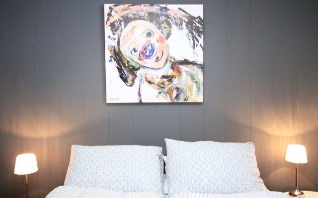Отель Nordic Host Apts - Vestregata 64A Tromsø комната для гостей