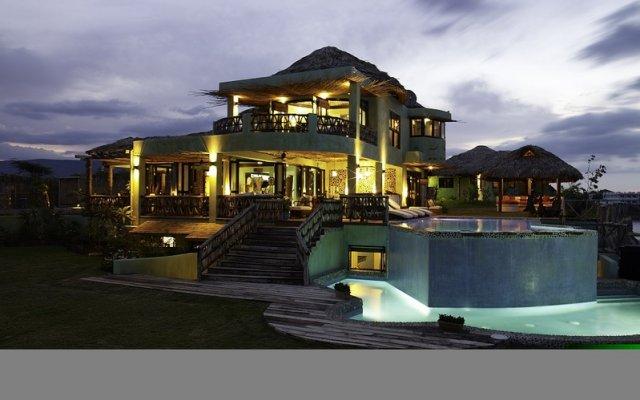 Отель Jakes Hotel Ямайка, Треже-Бич - отзывы, цены и фото номеров - забронировать отель Jakes Hotel онлайн вид на фасад