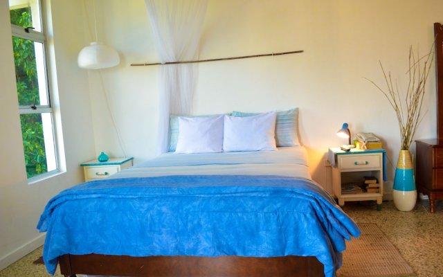 Отель Crystal Beach Studio Ямайка, Монтего-Бей - отзывы, цены и фото номеров - забронировать отель Crystal Beach Studio онлайн комната для гостей
