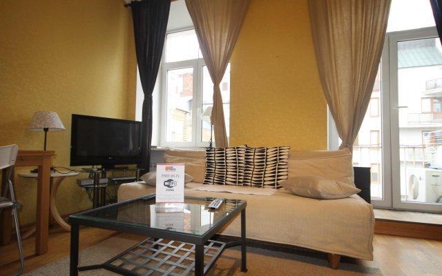 Апартаменты Four Squares Apartments on Tverskaya комната для гостей