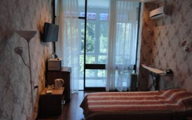 Светлана Плюс Отель комната для гостей