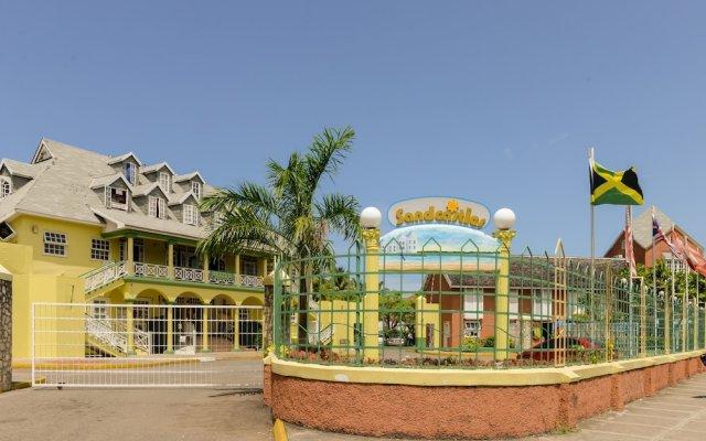 Отель SandCastles Deluxe Beach Resort вид на фасад