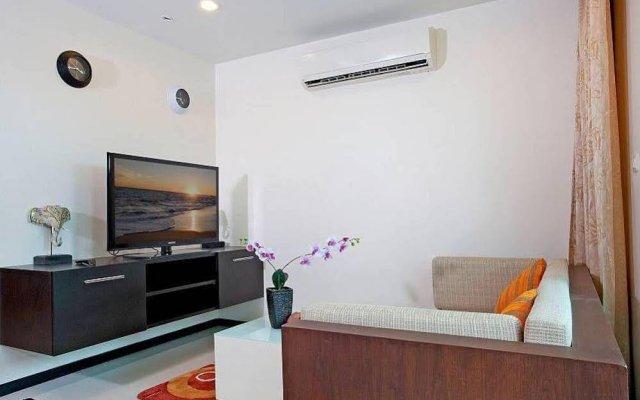 Апартаменты Kamala Chic Apartment комната для гостей