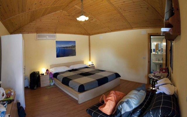 Отель Holiday Sun Lodge Appartamento Vacanze Джардини Наксос комната для гостей