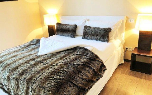 Отель Sopolitan Suites & Apartments GmbH Германия, Франкфурт-на-Майне - отзывы, цены и фото номеров - забронировать отель Sopolitan Suites & Apartments GmbH онлайн комната для гостей