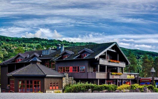 Отель Hunderfossen Hotell & Resort Hafjell Норвегия, Фаберг - отзывы, цены и фото номеров - забронировать отель Hunderfossen Hotell & Resort Hafjell онлайн вид на фасад
