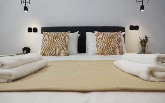 Отель Modern 2bed 2bath Loft in Acropolis area Афины комната для гостей